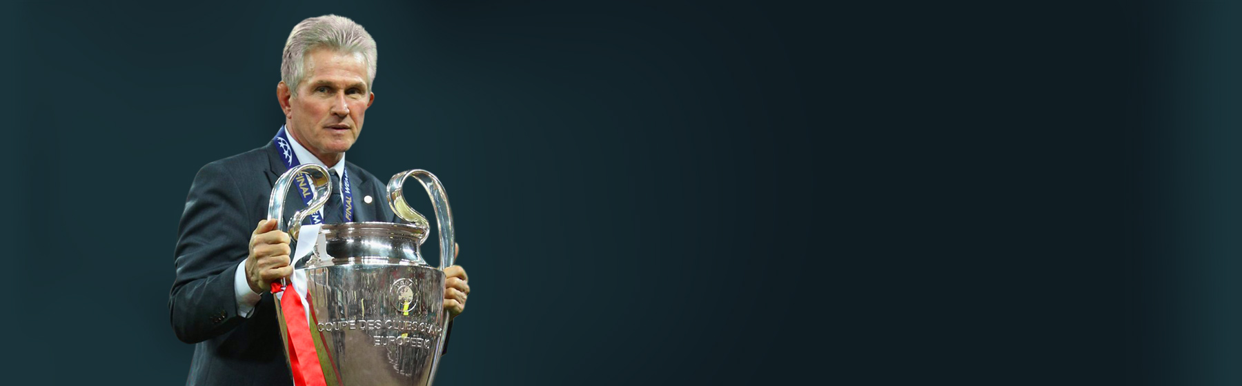 Jupp Heynckes with champions league trophy in hand - image-header