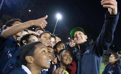 Aid organization Laureus Sport for Good - Mesut Özil takes a photo with needy children.