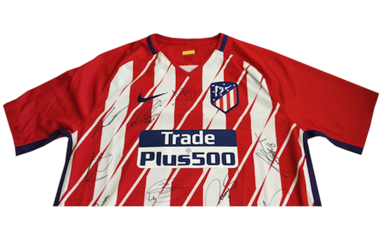 original jersey from Atletico Madrid signed by the whole team