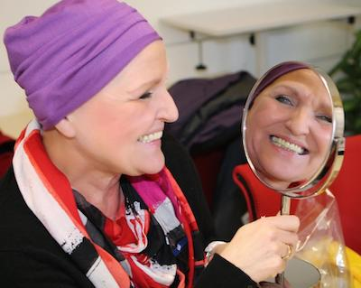 Aid organisation DKMS LIFE - cancer patient with headgear