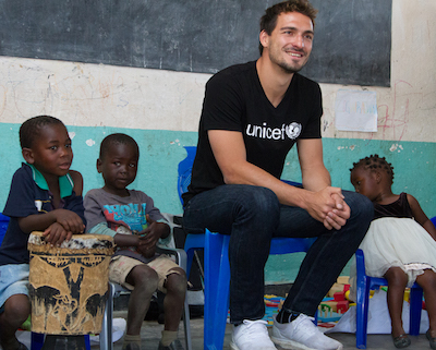 Aid organization UNICEF Mats Hummels with African children