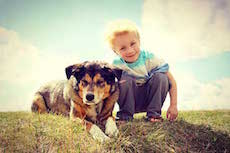 Child with dog - Kinder- und Jugendhaus Funk