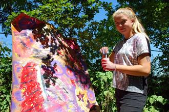 Artists for Kids Girl paints a work of art
