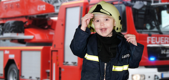 Child in firefighter clothes