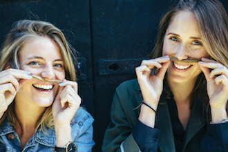 Two women with mustache - Movember Foundation