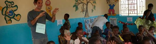 Roger Federer in a classroom of an African school