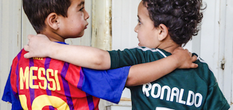 Two boys with jersey from Lionel Messi and Cristiano Ronaldo
